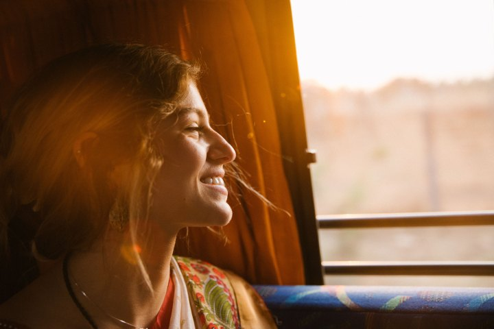 Girl smiling and looking out the window