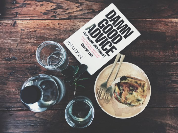 Breakfast, water, and a book called 'Damn Good Advice'