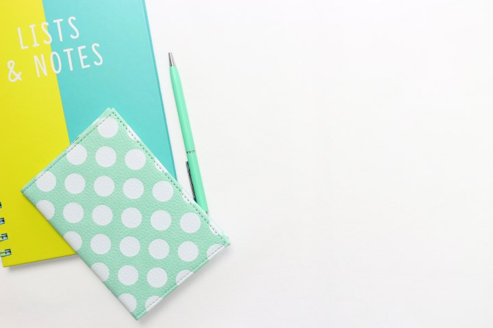 a pen, a planner, and a notebook that says 'lists & notes'