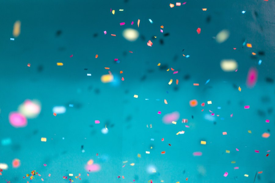 confetti falling over a blue background