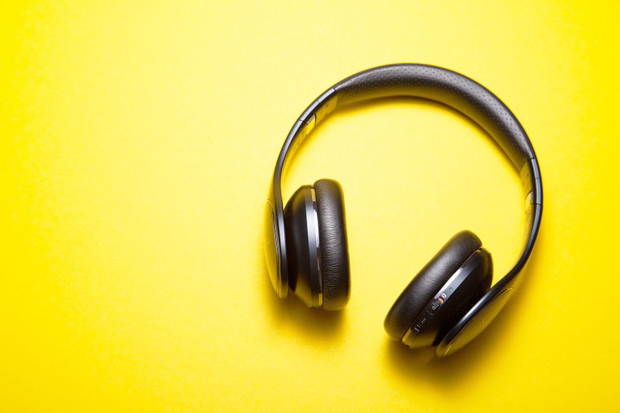 Headphones on a yellow background.