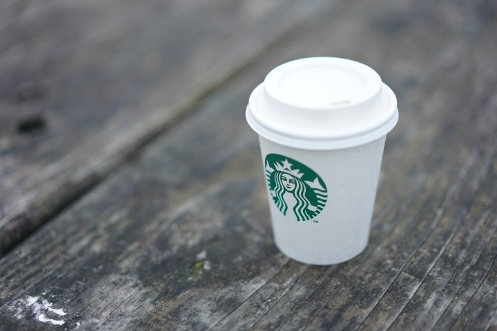 starbucks to-go cup on a table