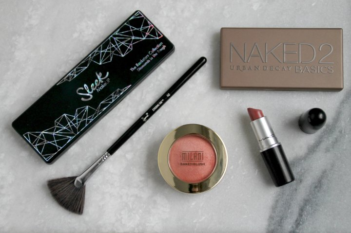 makeup products on a marble table