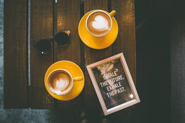 coffee mugs, sunglasses, and a picture that says 'inhale the future, exhale the past'